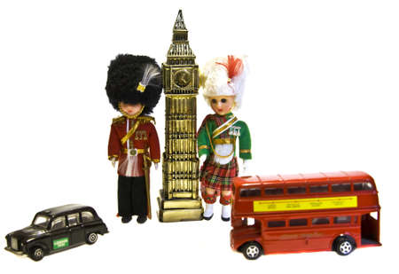 scotish: English souvenirs - symbols of London - Big Ben tower, toys of English and Scotish solgers, red bus and black taxi.
