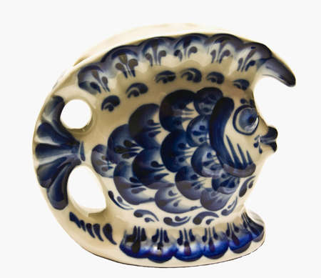 faience: Faience figurine of fish in white and blue coloures. Stock Photo