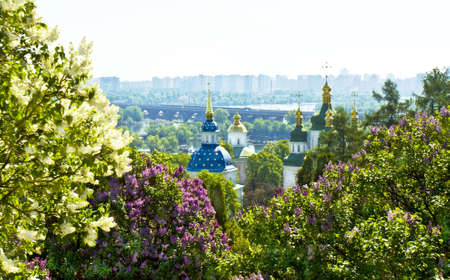 dnepr: Kiev, Ukraine - May 02, 2012: Vydubictkiy Mihaylovskiy monastery with view on river Dnepr and National Botanic garden in spring.