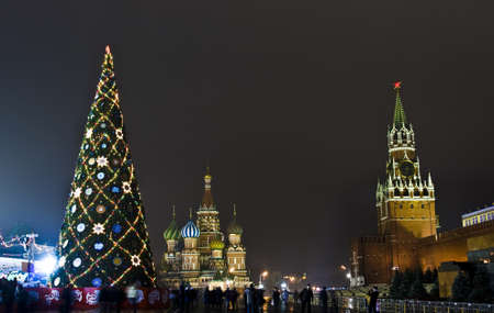 Moscow, Russia - December 14, 2011: Christmas tree on Red square, around Spasskaya Kremlin tower and St. Basil's Intercession (Pokrovskiy) cathedral. Stock Photo - 14844128