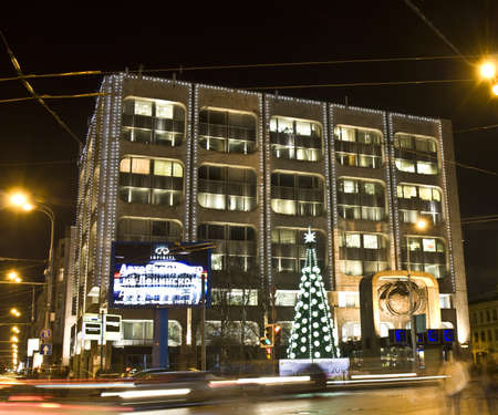 Moscow, Russia - December 19, 2011: Christmas tree on square Nikitskiye vorota and building of TASS (Telegraff agency).