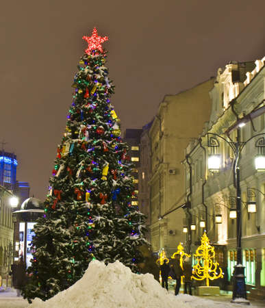Moscow, Russia - December 21, 2011: Christmas tree on Kamergerskiy side street.