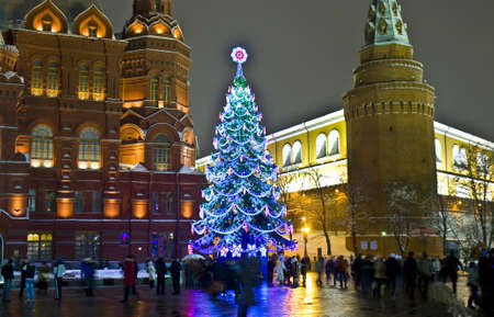 Moscow, Russia - January 09, 2012: christmas tree on Manezhnaya square, historical museum and Kremlin tower.