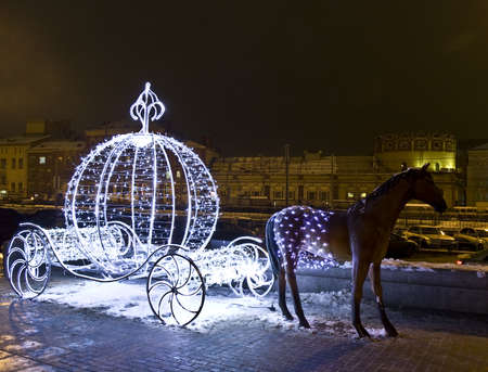 Moscow, Russia - January 02, 2012: Christmas decoration - horse with fairy-tale carriage from electric lamps, Komsomolskaya square.