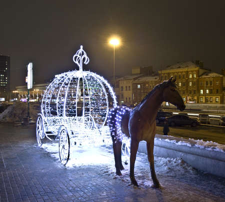 Moscow, Russia - January 02, 2012: Christmas decoration - fairy-tale horse with carriage from electric lamps, Komsomolskaya square.