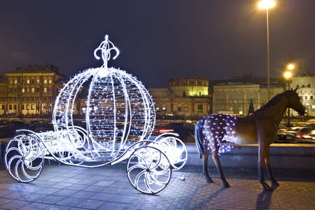 Moscow, Russia - January 06, 2012: christmas decoration on street - electric carriage with sculpture of horse.
