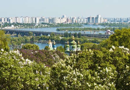 dnepr: Kiev (Kyiv), Ukraine - Vydubictkiy Mihaylovskiy monastery, X century, with Central Botanic Garden and river Dnepr. Stock Photo