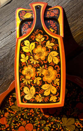 Wooden desk hand painted in traditional style called hohloma, Russia. Stock Photo - 15643983