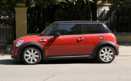 Autocar Mini Cooper in red and black colours.