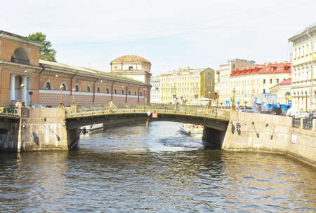 St. Petersburg, Russia - July 12, 2012: Small Stable bridge on river Moyka, unidentified people on the street. Stock Photo - 17063127