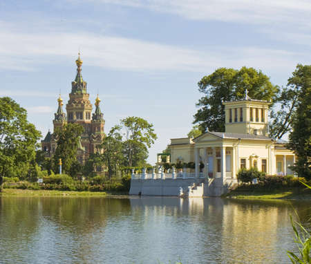 Peterhof, Russia - July 06, 2012  cathedral of St  Peter and St  Paul and palace of princess Olga in Peterhof, surroundings of St  Petersburg Stock Photo - 17465671