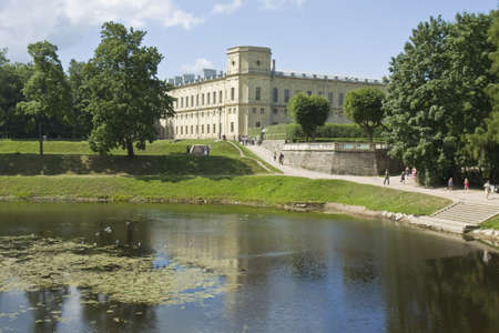 Gatchina, Russia - July 11, 2012: palace of king Pavel I in surroundings of St. Petersburg, unidentified people around.