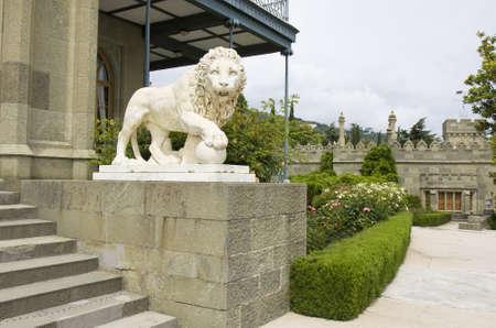 alupka: Alupka, Ukraine - May 25, 2012: Sculpture of stone lion near Vorontcovskiy palace in town Alupka in region Crimea in Ukraine.