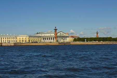 St  Petersburg, Russia - July 03, 2012  Vasilyevskiy island with building of Exchange and Rostral columns on bank of river Neva