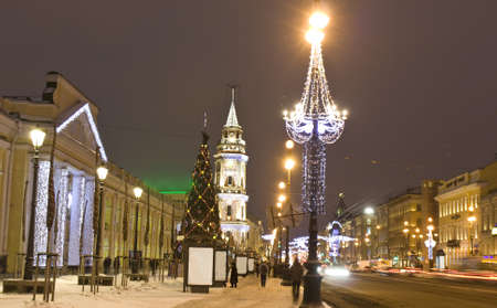 Nevskiy prospectus avenue in electric Christmas decoration and New Year - Christmas tree at night in St. Petersburg, Russia. photo