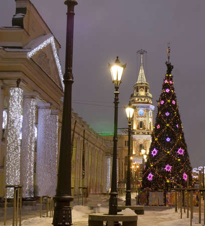 ST. PETERSBURG - DECEMBER 25, 2012: Christmas - New Year tree on Nevskiy prospectus avenue and buildings of Town Hall and Gostinniy Dvor shop in electric decoration for holidays, December 25, 2012, in town St. Petersburg, Russia.