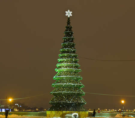 Christmas - New Year tree on the street on Vasilievskiy island in St. Petersburg, Russia. photo