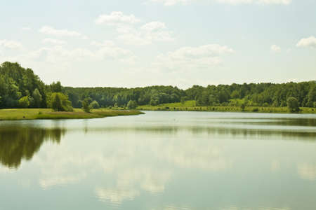 izmaylovskiy: Summer landscape with big lake and forest on banks, recorded on Swan lake in Izmaylovskiy park in Moscow. Stock Photo