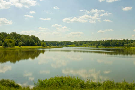 izmaylovskiy: Summer landscape with big lake and forest on banks, reflection of clouds in water. Recorded on Swan lake in Izmaylovskiy park in Moscow.