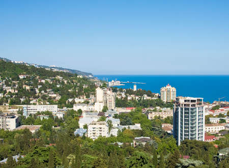 Panoramic sight of town Yalta, famous resort in region Crimea on Black sea in Ukraine. photo