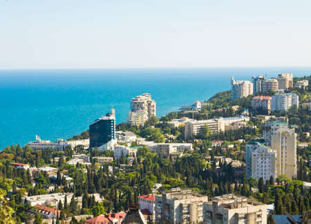 Panoramic sight of town Yalta, famous resort in region Crimea on Black sea. photo