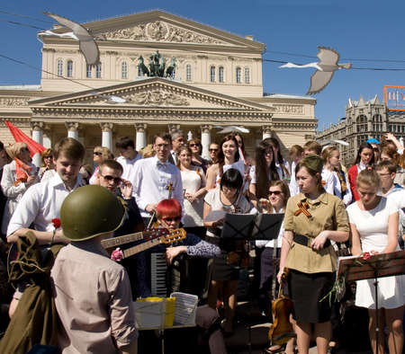 MOSCOW - MAY 9, 2014  Holiday Victory Day devoted to victory in Second World War, people sing war songs near Big Theatre   Editorial