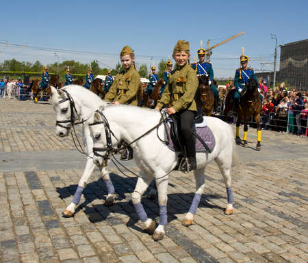 cavalry: MOSCOW - MAY 9, 2014: cavalry show in memorial  Poklonnaya hill devoted to holiday Victory day of victory in Second World War, participants President cavalry regiment and Kremlin cavalry school.