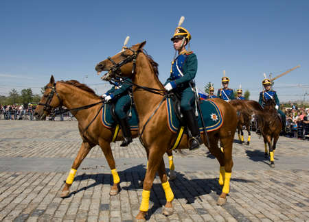 cavalryman: MOSCOW - MAY 9, 2014: cavalry show in memorial  Poklonnaya hill devoted to holiday Victory day of victory in Second World War, participants President cavalry regiment and Kremlin cavalry school.