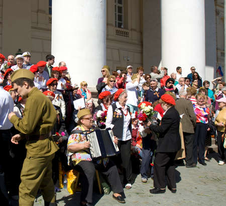 MOSCOW - MAY 9, 2014: Holiday Victory Day devoted to victory in Second World War, people sing war songs on steps of Big Theatre.