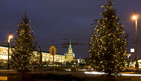 MOSCOW - DECEMBER 26, 2013  Christmas trees on Manezhnaya square and towers of Kremlin fortress