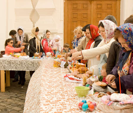 sanctification: MOSCOW - APRIL 19, 2014: Easter ceremony on church yard, consecration of Easter cakes and eggs. Editorial