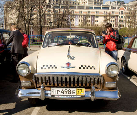 motorcar: MOSCOW - APRIL 27, 2014: Russian retro car Volga of 1969 on rally of classical cars, organized by Russian Club of Classical Autocars on Theatre square.