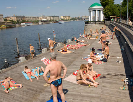 gorky: MOSCOW - MAY 23, 2014: moscovites and city visitors rest in Gorky park in summer. Park located in centre of the city has been founded in 1928, named by famous Russian writer Maxim Gorky in 1932.