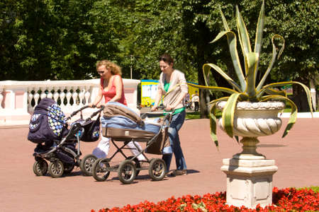 babby: MOSCOW - JUNE 12, 2014: women with babby carriage walk in Lefortovsky park. Lefortovsky park exist from 17 century and was real estate of Russian kings.