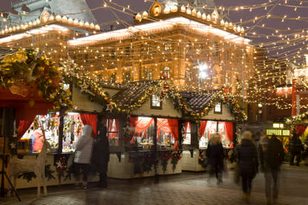 MOSCOW - DECEMBER 24, 2014: Christmas fair (market) on Manezhnaya square. Editorial