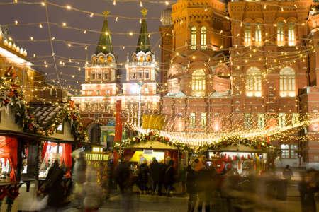 MOSCOW - DECEMBER 24, 2014: Christmas fair (market) on Manezhnaya square. Editorial