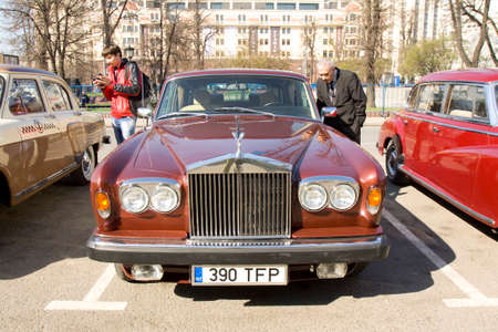motorcar: MOSCOW - APRIL 27, 2014: retro car rolls royce on rally of classical cars, organized by Russian Club of Classical Autocars on Theatre square.
