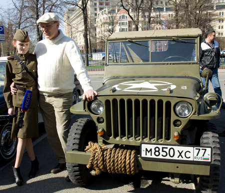 mb: MOSCOW - APRIL 27, 2014: American retro car Willys MB on rally of classical cars, organized by Russian Club of Classical Autocars on Theatre square.
