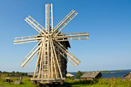 onega: Old wooden windmill and houses on island Kizhi on Onega Onezhskoye lake in region Karelia on North of Russia, UNESCO World Heritage site.