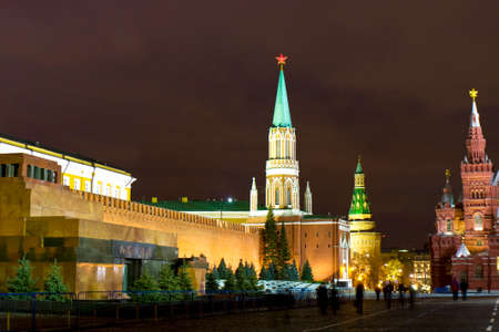 saint nicholas: Moscow, Russia - December 19, 2013: Saint Nicholas tower and Corner Arsenal towers of Kremlin fortress, mausoleum of Lenin and part of Historical museum on Red square at night. Editorial