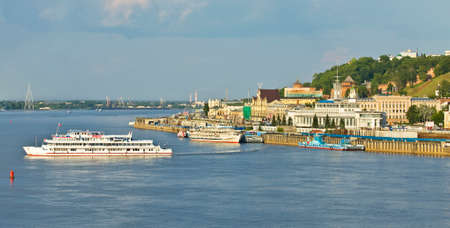 middle ages: NIZHNIY NOVGOROD, RUSSIA - JUNE 03, 2013: river port on Volga, has been built in 1967, and middle ages fortress Kremlin of 16 century. Editorial