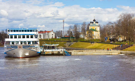 uglich russia: UGLICH, RUSSIA - MAY 01: Cruise touristc ship arrives in port of town Uglich on river Volga and orthodox church of Resurrection of Jesus Christ on May 01, 2013 in  Uglich, Russia. Church has been built in 1762.
