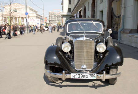 motorcar: MOSCOW - APRIL 27, 2014: retro car mercedes on rally of classical cars, organized by Russian Club of Classical Autocars on Theatre square, Big (Bolshoy) theatre behind. Editorial