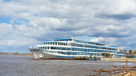 uglich russia: UGLICH, RUSSIA - MAY 01: tourist excursion ship arrives in port of historical town Uglich in cruise on river Volga on May 01, 2013 in Uglich, Russia.