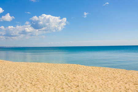 helen: Seascape with calm blue sea, little clouds and sandy beach, recorded in Saint Constantine and Saint Helen resort, Bulgaria.