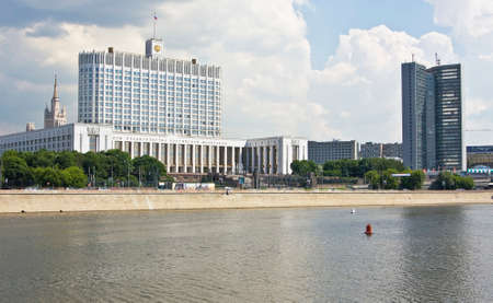 built in: MOSCOW - MAY 23 2010: House of Russian Government Russian White house, built in 1979, and building of Moscow Government, known as house-book, built in 1963-1970, on Krasnopresnenskaya quay