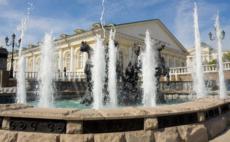 has been: MOSCOW - MAY 15, 2014: fountain  Geyser,  has been erected in 1996, and exhibition hall Manezh, has been built in  1817, on Manezhnaya square.