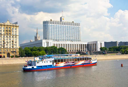 MOSCOW - MAY 23 2010: House of Russian Government (Russian White house), has been built in 1979 and excursion boat on Moskva-river.