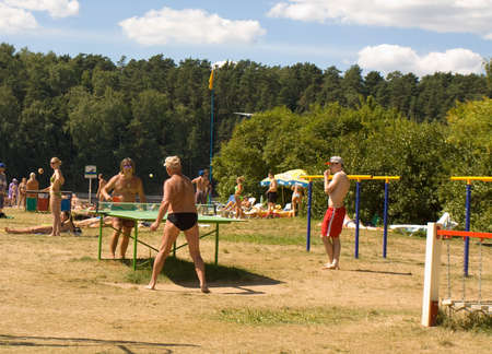 play popular: MOSCOW - JULY 20, 2014: people play table-tennis on beach in Serebryany bor (Silver forest) on Moskva-river, one of the most popular beaches of the city.