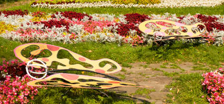 flowerbeds: Original flowerbed with sculptures of butterflies, begonia, coleus and cineraria, recorded on Exhibition of flowerbeds in park Kuzminki, Moscow, August 2013 year.